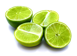 Group of sliced lime halves isolated on white studio background.