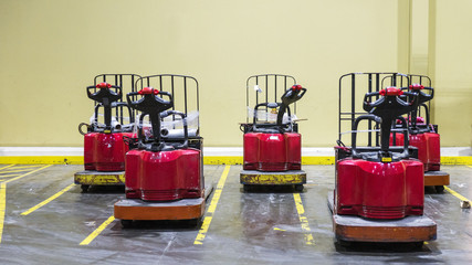 Forklifts or pallet jacks in a formation in a warehouse