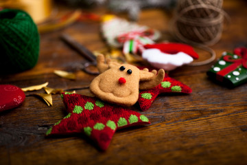 Christmas background with decorations and handmade gift boxes on old wooden board, vintage filter effect