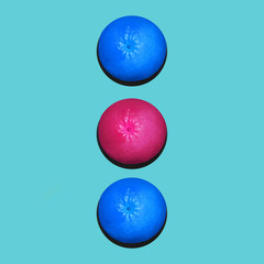 Grapefruit in flat lay Two blue and one pink grapefruits are lying in a row on blue background Top view Modern flat lay photo in pop art style with space for text