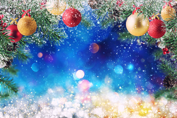 Christmas decoration with snow, pine and ball with sparkly background