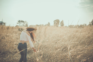 Close up of asian woman slim smiling in the field on sunset vintage style