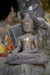 Buddhist Statue in Pak Ou Caves, Luang Prabang, Laos.