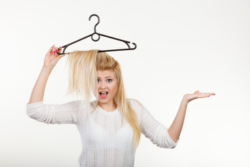 Woman holding hair on clothes hanger