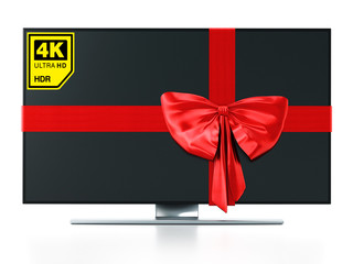 4K Ultra HD TV wrapped with red ribbon. 3D illustration