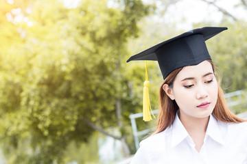 Asian female student graduate  in public park