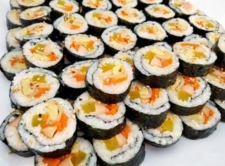 Kimbap or gimbap seaweed rice rolls on white background, Korean food