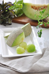 Pieces of Honeydew Melon on White Plate