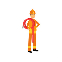 Fireman in uniform and protective helmet, holding roll of water hose on his shoulder