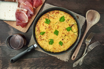 Spanish tortilla in tortillera, with wine, jamon, and cheese