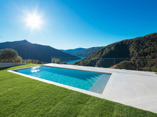 Modern swimming pool with lake and valley view
