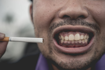 Cigarette with mouth,no world tobacco day,selective focus