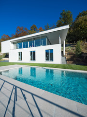 Modern white house with garden