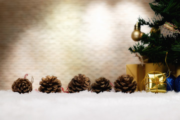Christmas decorations with snow and red background.close up and selective focus.
