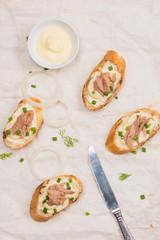 Bruschetta. Sandwich tuna fish salad on wooden background