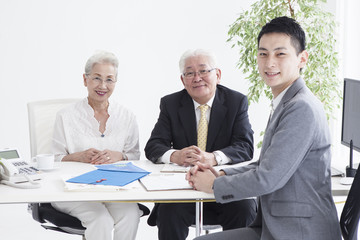 Elderly couple and salesperson's portrait