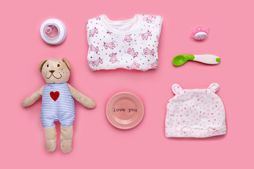 Cute toddler (girl) accessories on a pink background shot knolling style.