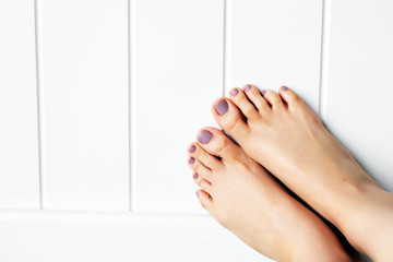 Selfie Female Feet with Nail Pedicure looking up, Raised Straight Up. Barefeet in Bedroom Background Great for Any Use