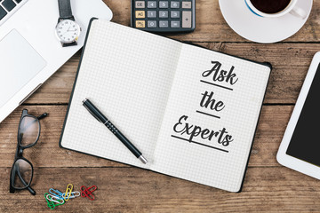 Ask the Experts on note book at office desktop
