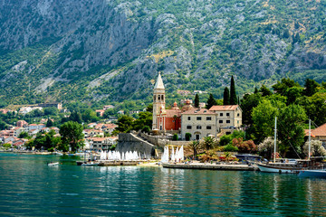 The Church of St. Matthew (1670) with the bell tower and the Church of the Merciful Virgin (15th century) along the Boka Bay of Kotor, Montenegro