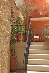 Photo made in Greece. Patio in Greece with stairs and flowers