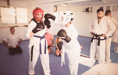 Women practicing at taekwondo class