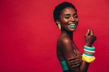 Smiling female model with artistic makeup Fotoväggar