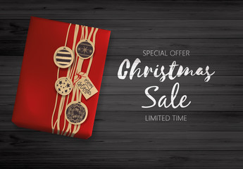 Christmas Sale Design. Lettering on Black Wooden Board with Giftbox