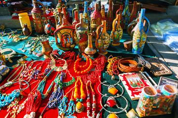 Tbilisi, Georgia - 08 October, 2016: Dry Bridge Flea market in Tbilisi sells Jewelry, Soviet, retro junk stuff, tableware set, dishes, souvenir georgian Clay jugs