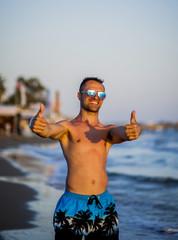 A cute boy posing near the sea