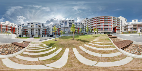 Full 360 degree panorama in equirectangular spherical projection in stylish apartment complex Koruni. Photorealistic VR content