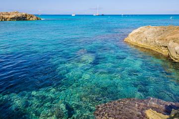 Transparent sea in Es Calo Cove in Formentera, Spain