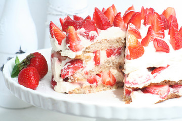 Cake with strawberries and cream
