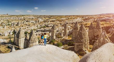 Couple of woman hikers enjoying valley view in Cappadocia, Turkey,
