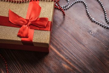 A box for a Christmas present on a wooden background