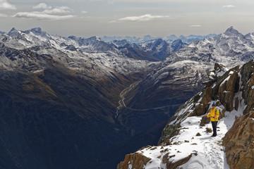 Austria, Tyrol, Oetztal, Soelden, woman at Gaislachkogel with view to Oetztal Alps
