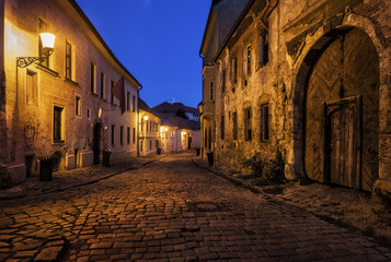 Slovakia, Bratislava, Old Town at night, cobbled street, old building with aged facade