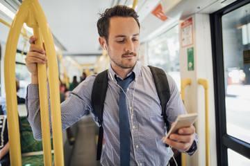 Businessman Commuting By Tram In Melbourne