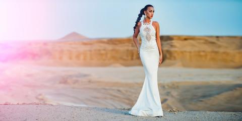 Woman posing in desert