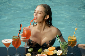 Cocktail and sexy girl in pool.