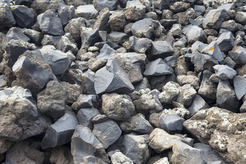 The texture of the volcanic stone from the island of Santorini.