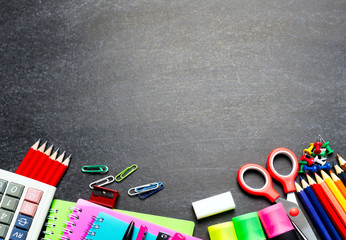 Back To School Concept - School Supplies and Stationery on Blackboard Background.