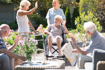 Woman in wheelchair in garden