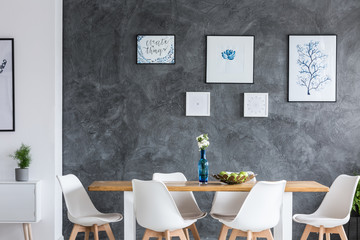 Monochromatic dining room with gallery