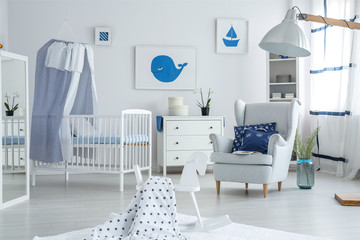 Armchair in bright baby's bedroom