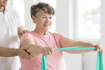 Senior woman during individual rehabilitation