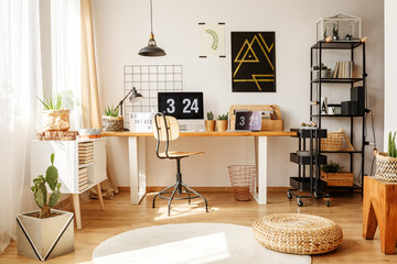 Stylish home office with pouf