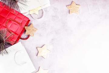 Flat lay top view Christmas background with golden stars and paper bags