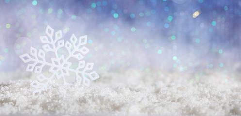 Snowflake on Christmas snowy bokeh background