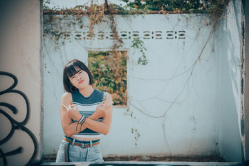 Portrait of hipsters asian beautiful teen girl outdoor